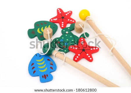 Wood fishing game - catch the fish with the magnetic rod - stock photo