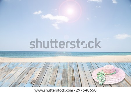 Wood floor and hat on beach sky and cloud background  - stock photo