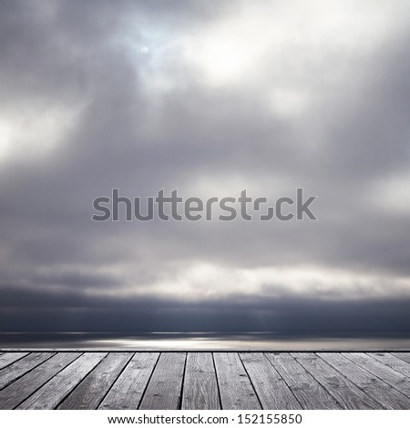 wood floor and somber sky and see