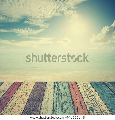 Wood floor on beach  sea and blue sky for background.Copy space.Vintage Tone - stock photo