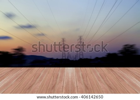 Wood floor on high voltage post.image motion blur for background - stock photo