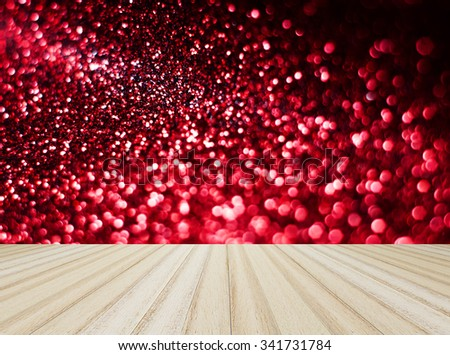 Wood floor on red bokeh background - stock photo