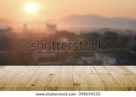 Wood floor or table with blurred abstract background of city sunlight downtown city view : Wooden table with blur background of cityscape