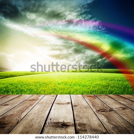 Wood floor texture over green field under blue sky. Beauty nature background - stock photo