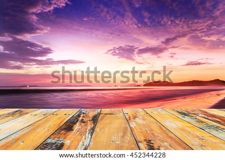 Wood floor top on sunset sky background, Cloudy in orange sky and wood berth, used for display your products. - stock photo
