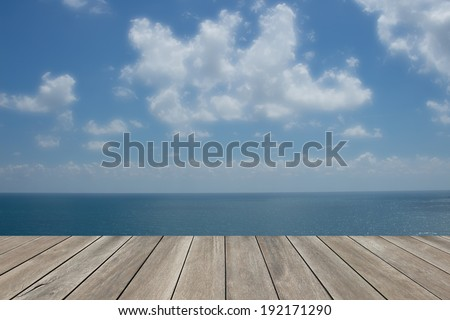 Wood floor with blue sea sky background - stock photo