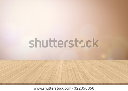 Wood floor with edge in yellow brown color tone on blurred abstract background of warm morning sunrise bokeh with flare from the kitchen balcony: Wooden table with blur cityscape view with gold light - stock photo