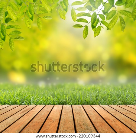 Wood floor with yellow bokeh and sunlight - stock photo