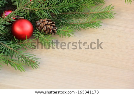 Wood flooring and spruce branches