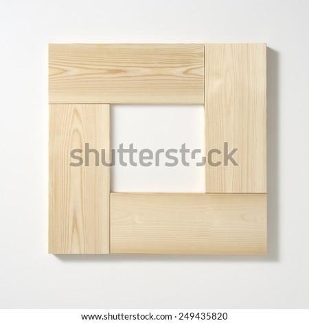 wood frame on white wall - stock photo