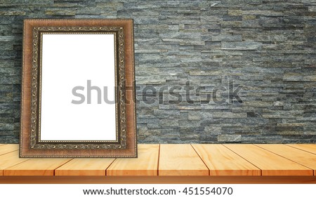 wood frame on wooden shelves and stone wall background. For product display - stock photo