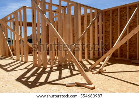 wood frame residential construction site - Wood Frame House