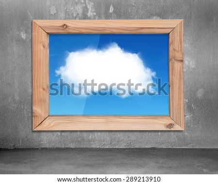 Wood frame window with view of  white cloud blue sky, on concrete wall and floor indoors background. - stock photo