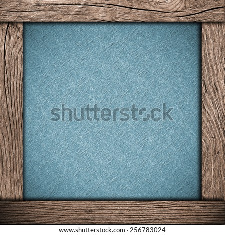 wood frame with blue paper - stock photo