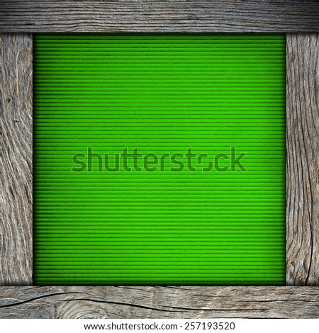 wood frame with green paper - stock photo