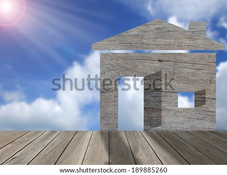 Wood home icon with blue sky background,environment concert