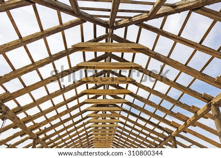 Wood house roof skeleton under construction - stock photo
