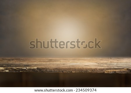 wood in light and grunge wall background - stock photo