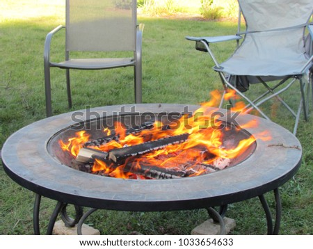 Wood Is Burning In A Portable Backyard Fire Pit Ready To Toast Snacks;  Landisville,