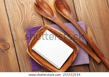 Wood kitchen utensils over wooden table background with copy space - stock photo