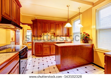 Wood kitchen with yellow walls. Old American craftsman style home with lots of wood details. - stock photo