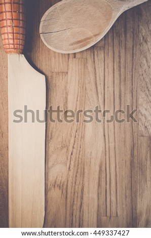 wood knife and spoon on a natural wood table surface - vintage look