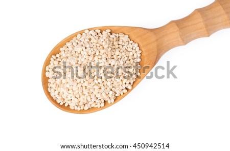 wood ladle of Barley rice isolated on white background - stock photo