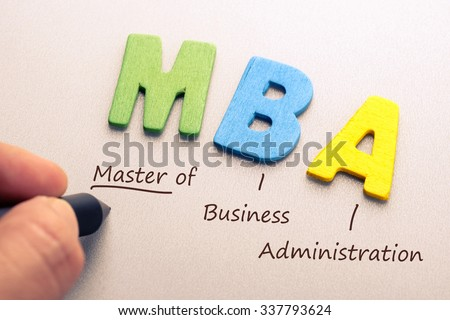 Wood letter of MBA abbreviation with hand writing definition - stock photo