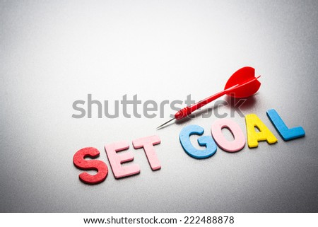 Wood letters of Set Goal word with dart - stock photo