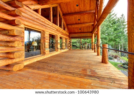 Wood log cabinet porch exterior. - stock photo