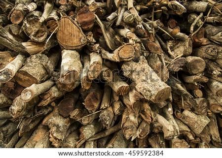Wood log pile texture - stock photo