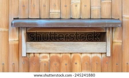 Wood mail box on traditional bamboo wall background - stock photo