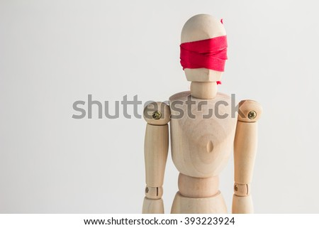 wood man figure blind with red ribbon and copy space for your idea - stock photo