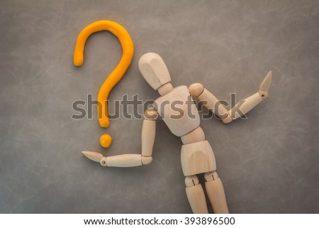 wood man with question mark business solution concept on grey background - stock photo