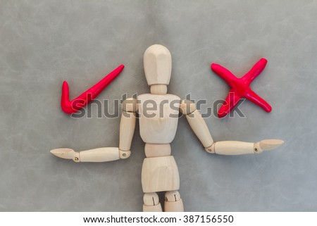 wood man with right and wrong symbol business solution concept - stock photo