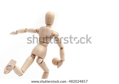 Wood manikins play bowling pose on white background.