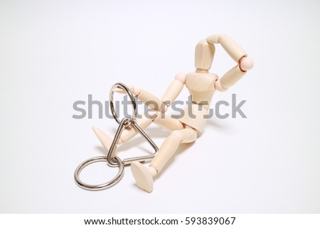 Wood mannequin and wisdom ring on white background Problem solving