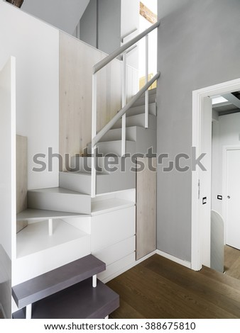 wood modern staircase in the apartment overlooking on the landing - stock photo