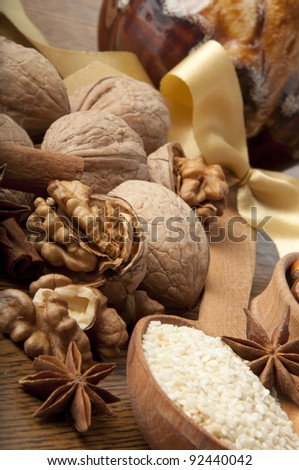 Wood nut, walnut, anise, cinnamon and sesame against a dark background