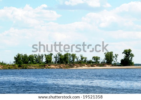 Wood on the coast of the quiet river