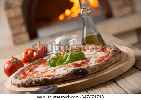 Wood oven baked italian pizza margherita - stock photo