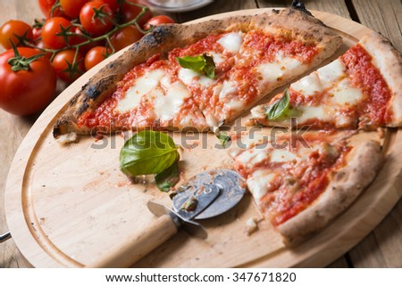 Wood oven baked italian pizza margherita - stock photo
