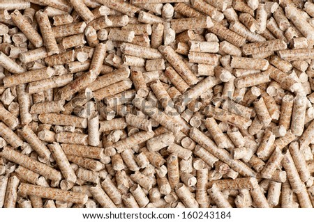 Wood pellet background pattern - stock photo