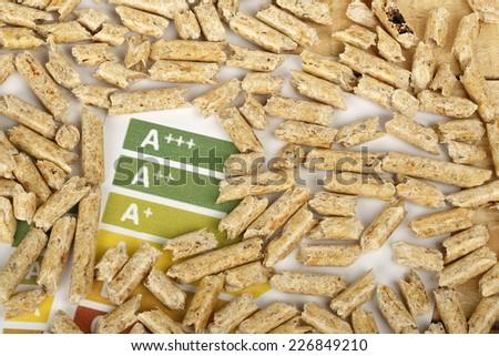 wood pellets on energy efficiency graph - stock photo