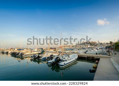 Wood pier with recreational boats in Eivissa marina - stock photo