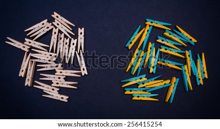 Wood pins on paper black background - stock photo