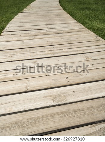 Wood plank and green grass texture background - stock photo