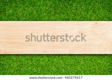 Wood plank on Grass background