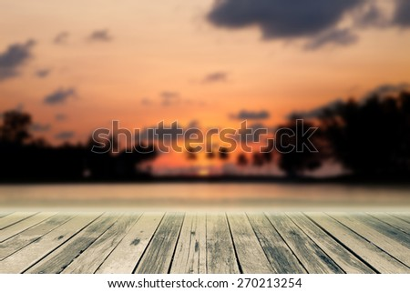 Wood plank  on sunset sky background blur - stock photo