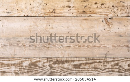 Wood plank red cool tone texture background horizontal direction. Image of pine tree natural gnarled planks siding with well visible texture in cooler tone with red tint. - stock photo